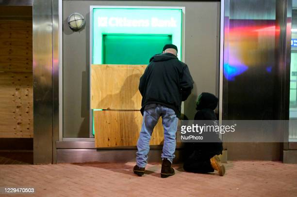 Workman board up a Citizens Bank ATM, located on Market Street in Center City Philadelphia, PA on November 4, 2020.