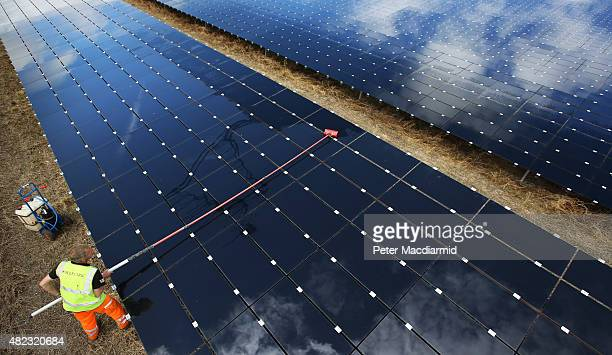 A workman cleans panels at Landmead solar farm on July 29 2015 near Abingdon England The 46 megawatt capacity installation was the largest in the...