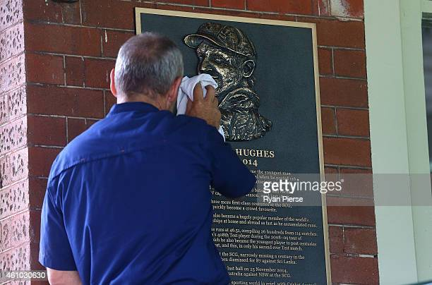 A workman cleans the commemorative plaque erected in a tribute to the late Phillip Hughes during an Australian nets session at Sydney Cricket Ground...