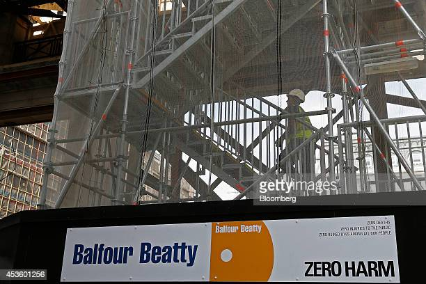 A workman climbs a scaffold staircase during building works at Balfour Beatty Plc's St James's Market construction site a joint Crown Estate and...