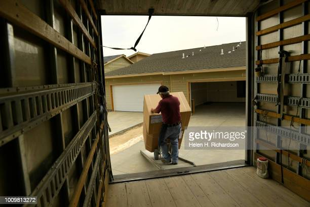 A workman delivers cabinets for a new home in the Beeler Park neighborhood of Stapleton on August 1 in Denver Colorado Developer Forest City is about...