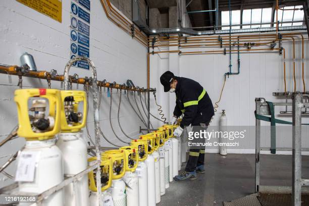 Workman handles some oxygen cylinders at Sapio production plant on April 01, 2020 in Caponago, near Milan, Italy. The Sapio Group is an Italian...