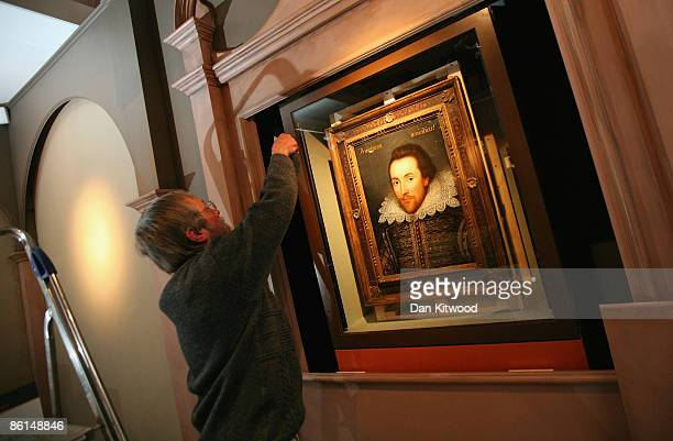 A workman hangs a portrait of William Shakespeare at The Shakespeare Birthplace Trust on April 17 2009 in StratforduponAvon England The recently...