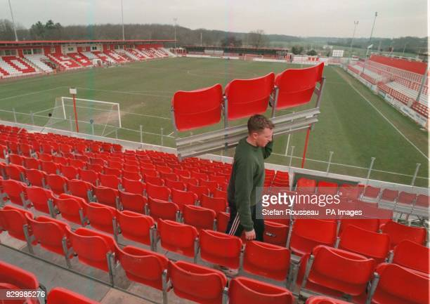 Workman helps erect the new stand at Stevenage Borough Football Club, which will accomodate visiting Newcastle supporters for their FA Cup match on...