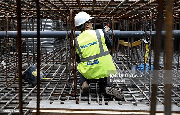 A workman installs concrete reinforcement rods during building works at Balfour Beatty Plc's St James's Market construction site a joint Crown Estate...