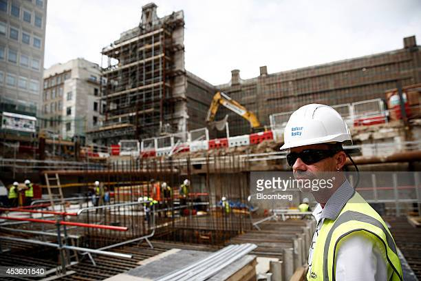 A workman looks out over Balfour Beatty Plc's St James's Market construction site a joint Crown Estate and Oxford Properties Group Inc commercial...
