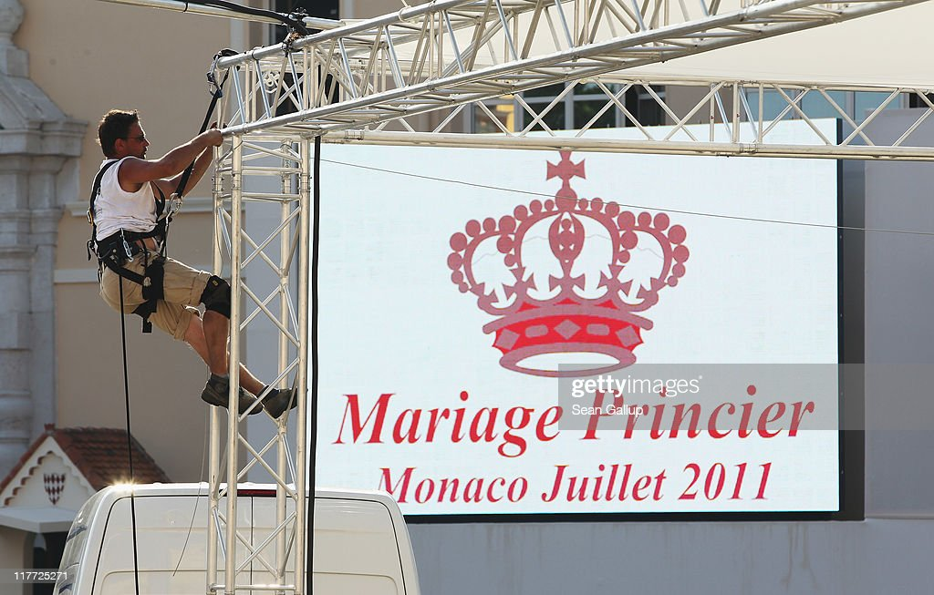 A workman makes preparations ahead of the Royal Wedding of Prince Albert II of Monaco to Charlene Wittstock on June 30, 2011 in Monaco. The civil ceremony will take place in the Throne Room of the Prince's Palace of Monaco on July 1, followed by a religious ceremony to be conducted in the main courtyard of the Palace on July 2. With her marriage to the head of state of Principality of Monaco, Charlene Wittstock will become Princess consort of Monaco and gain the title, Princess Charlene of Monaco. Celebrations including concerts and firework displays are being held across several days, attended by a guest list of global celebrities and heads of state.