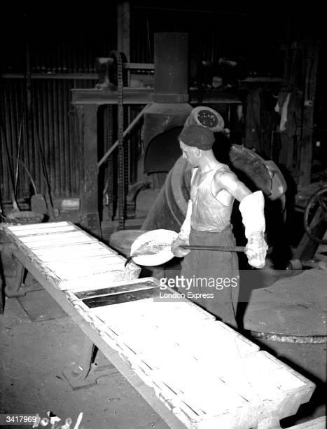 Workman making casting aluminium ingots.
