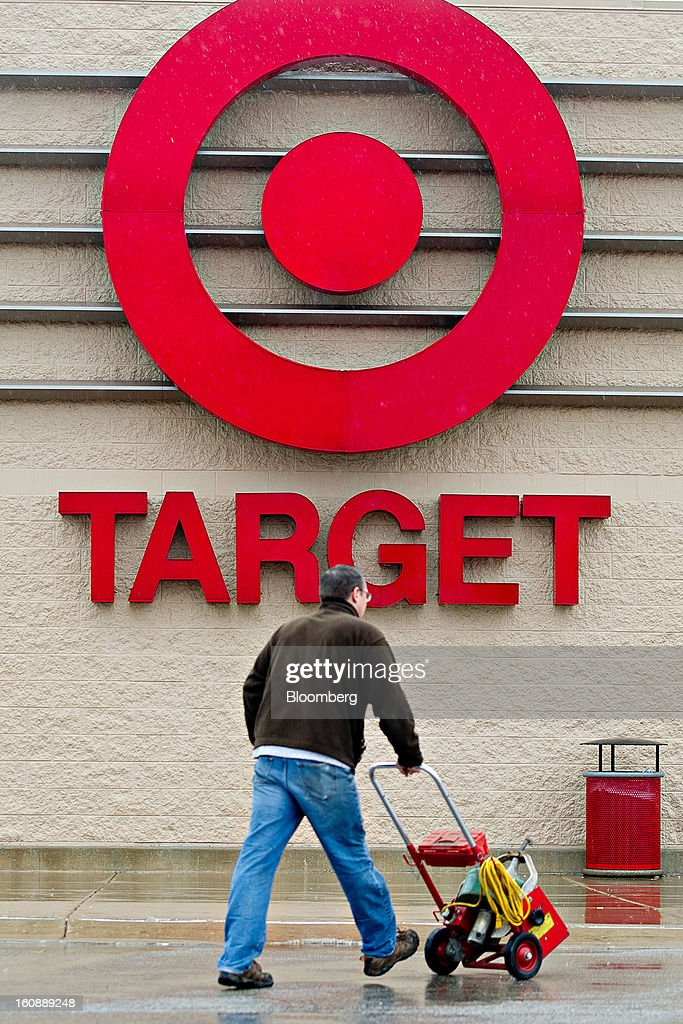 A workman pushes a cart of plumbing supplies into a Target Corp. store in Peru, Illinois, U.S., on Thursday, Feb. 7, 2013. Target Corp. led U.S. retailers to the biggest monthly same-store sales gain in more than a year as shoppers snapped up discounted merchandise chains were clearing out after the holidays. Photographer: Daniel Acker/Bloomberg via Getty Images
