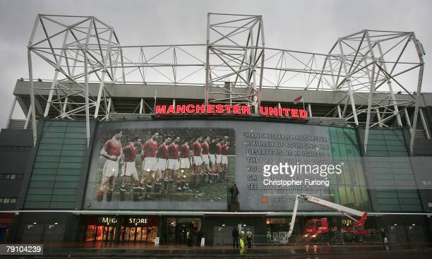 Workman put the finishing touches a giant mural commemorating the famous Busby Babes on the front of Manchester United's football stadium at Old...