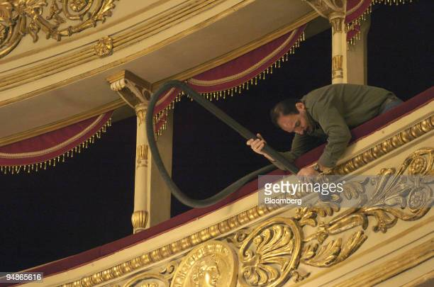 A workman puts the finishing touches to renovation work at La Scala opera house in Milan Italy Friday November 19 2004 La Scala reopens December 7...
