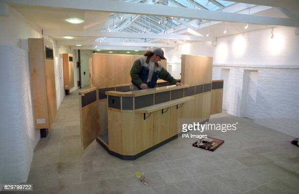 A workman puts the finishing touches to the new ticket office at Windsor Castle following restoration after the fire