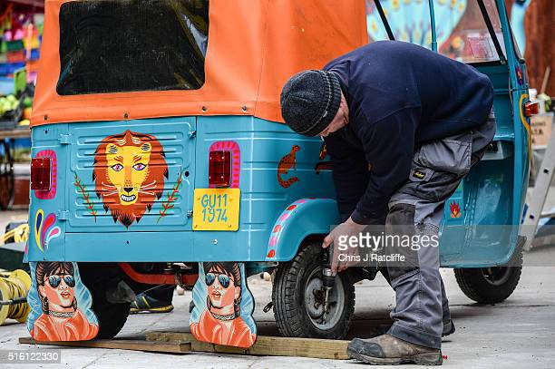 A workman puts the wheels on a rickshaw at the new lion enclosure 'Land Of The Lions' at London Zoo on March 16 2016 in London England The enclosure...