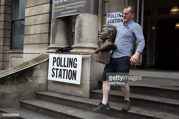 Workman removes the head of Joseph Stalin at the polling station at Shoreditch Town Hall during the UKs EU Referendum Polling Day on June 23rd 2016...