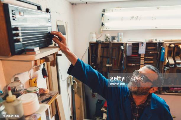 workman turns on the radio - radio stock pictures, royalty-free photos & images