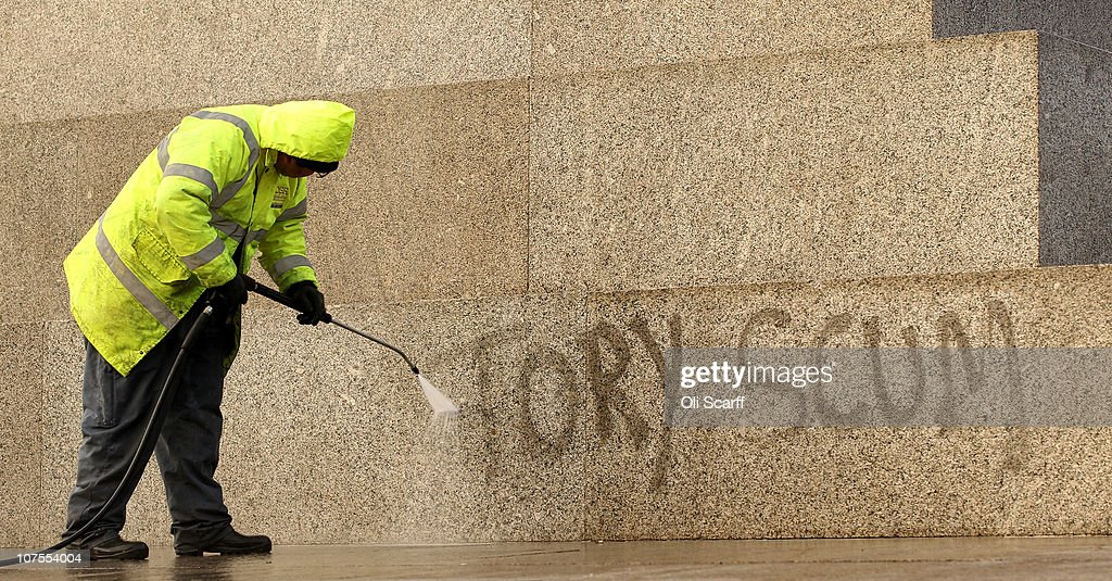 A workman uses a high pressure hose to clean graffiti from the base of Nelson's Column in Trafalgar Square on December 13, 2010 in London, England. The graffitied words 'Tory Scum' were written on the monument during a recent protest by students concerning the Government's proposals to increase tuition fees and scrap the Education Maintenance Allowance (EMA).