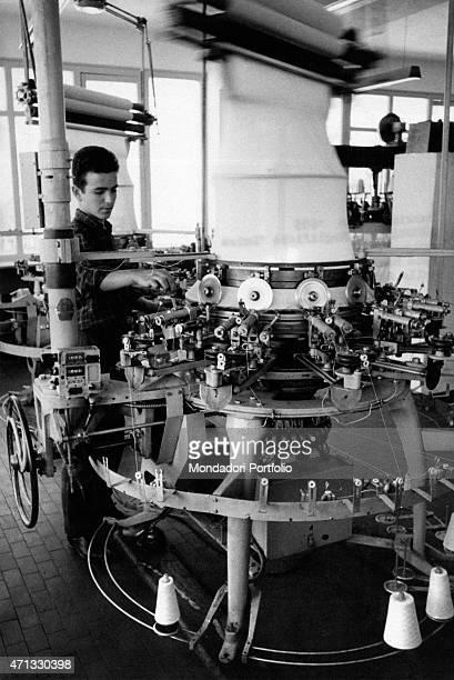 A workman using the equipment at Italian entrepreneur Luisa Spagnoli s  knitwear factory Umbria June 1955 fa992bc14b0