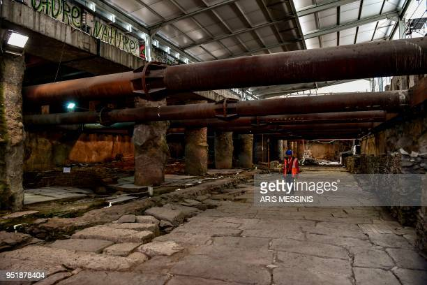 A workman walks on the remains of a crossroads of the Decumanus Maximus at an ancient site under the central avenue of the city of Thessaloniki on...