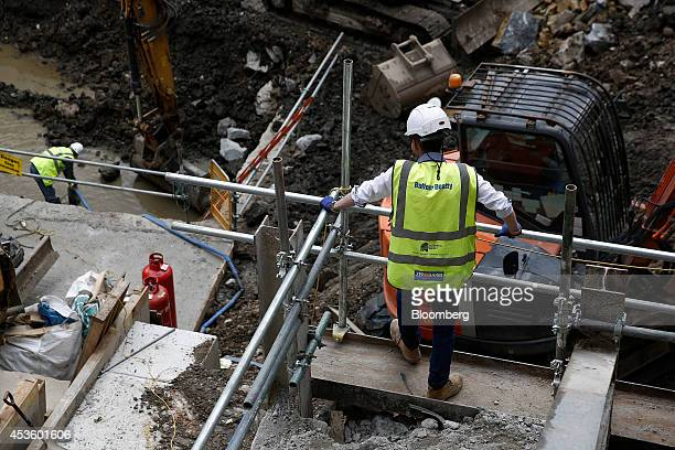 A workman watches was rubble is excavated during building works at Balfour Beatty Plc's St James's Market construction site a joint Crown Estate and...