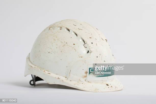 A workman's helmet found on the shore of the Thames Estuary on January 2 2018 in Rainham Kent Tons of plastic and other waste lines areas along the...