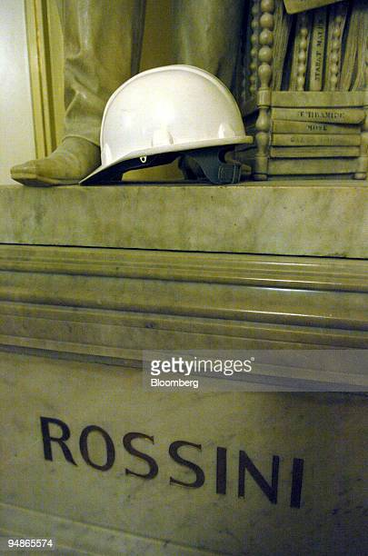 A workmans safety helmet seen on the plinth of a statue of Rossini at La Scala opera house in Milan Italy Friday November 19 2004 La Scala reopens...