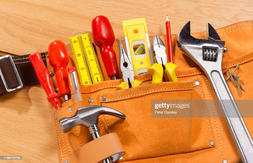 Workman's toolbelt ready for building maintenance work : Stock Photo