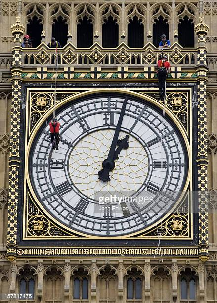 Workmen Abseil Down The Clock Tower Of Parliament Which Houses Big Ben To Inspect The Clock Face For Damage