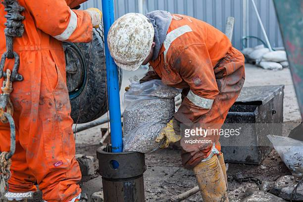 Workmen and a borehole