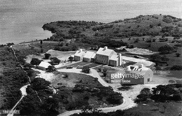 Workmen and gardeners putting finishing touches on new home of Jackie Onassis on southerly tip of Martha's Vineyard Photos made of the summer home...
