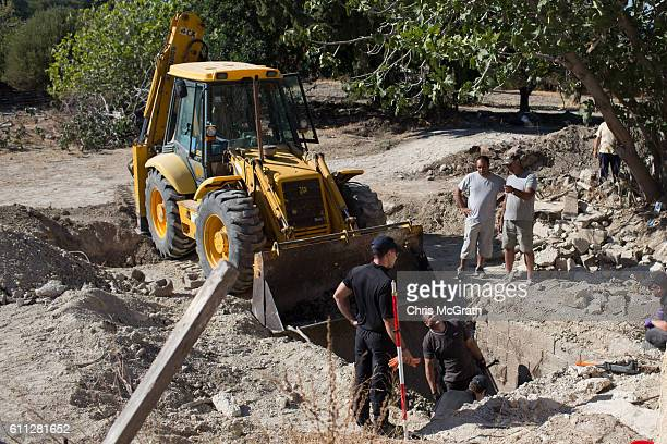 Workmen and South Yorkshire Police excavate a septic tank in search of missing toddler Ben Needham on September 29 2016 in Kos Greece The 21 month...