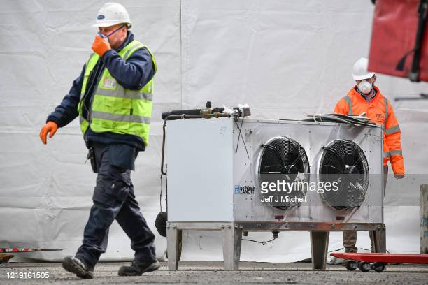 Workmen are seen at a warehouse, which is currently being converted into a body storage facility to accommodate up to 1700 bodies during the...