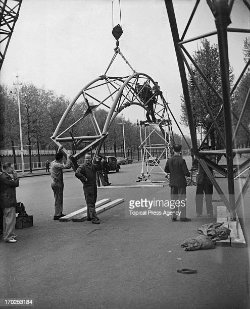 Workmen assemble the Triumphant Arches to be used as part of the decorations for the upcoming Coronation London 12th May 1953