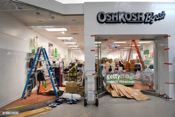 LAKEWOOD CO NOVEMBER 20 Workmen at OskKosh B'Gosh work inside the store in anticipation of the reopening of Colorado Mills Mall on November 20 2017...