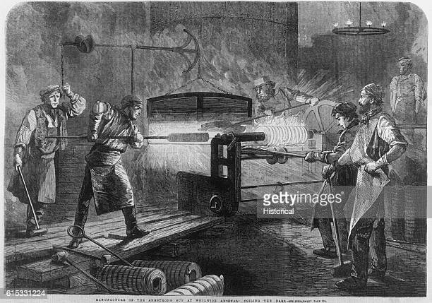 Workmen at the Royal Woolwich gunfactory coiling the bars to be used in the manufacture of an Armstrong gun ca 1862