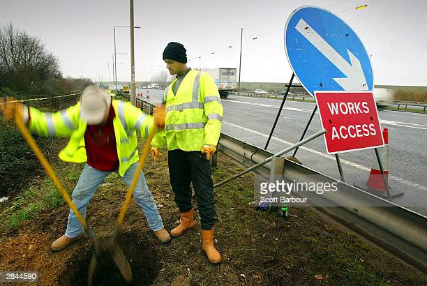 Workmen begin work on the widening of the M25 motorway on January 5 2004 in London The twoyear project will see a sevenmile section of the M25...