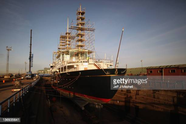 Workmen carry out painting and repairs on the Royal Yacht Britannia in a dry dock at Forth Ports on January 13 2012 in Edinburgh Scotland The Royal...