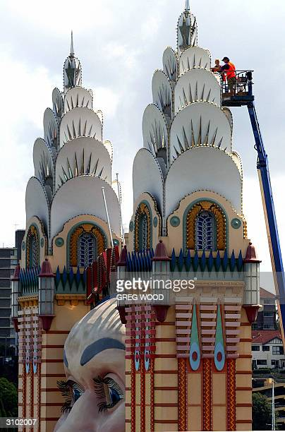Workmen clean an entrance column next to the famous face of Sydney's Luna Park 17 March 2004 in preparation for its official reopening on 02 April...