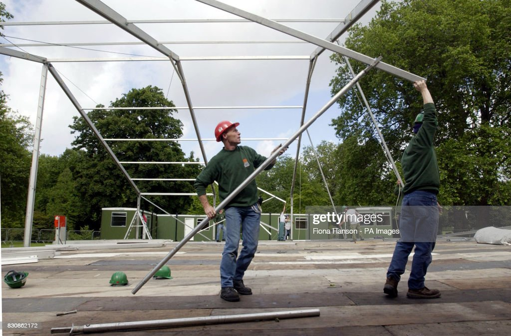 Workmen construct a tented area which will serve as dressing rooms for the performers in the & Royalty - Queen Elizabeth II Golden Jubilee Pictures | Getty Images