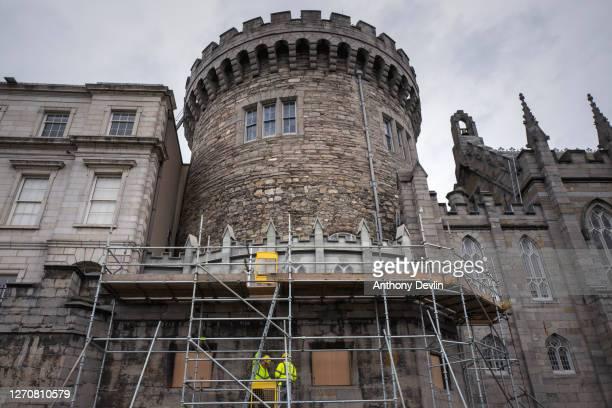Workmen construct scaffolding on Dublin Castle on August 04, 2020 in Dublin, Ireland.