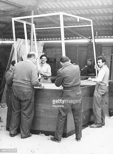 Workmen constructing the bullet proof dock in which Adolf Eichmann will appear during the war crimes trial Jaffa Israel February 3rd 1961