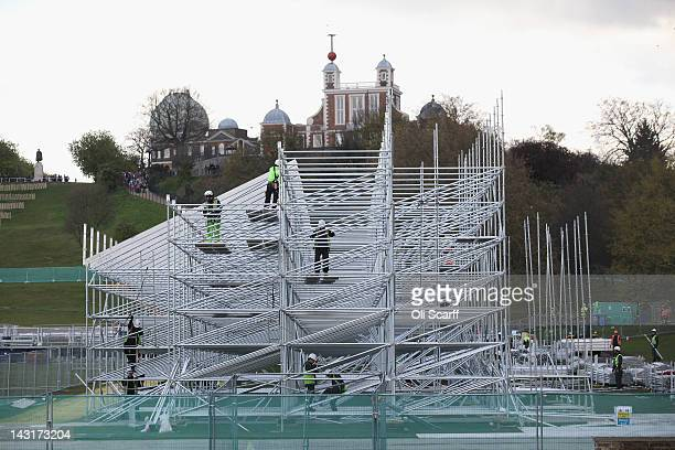 Workmen continue the scaffolding construction of the grandstands of the Olympic showjumping arena in Greenwich Park on April 20 2012 in London England