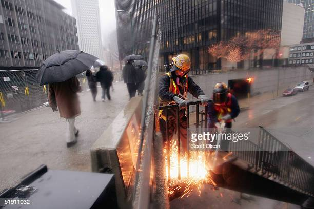 Workmen cut away a staircase outside the former Chicago Sun-Times newspaper building January 3, 2004 in Chicago, Illinois. The building, in downtown...