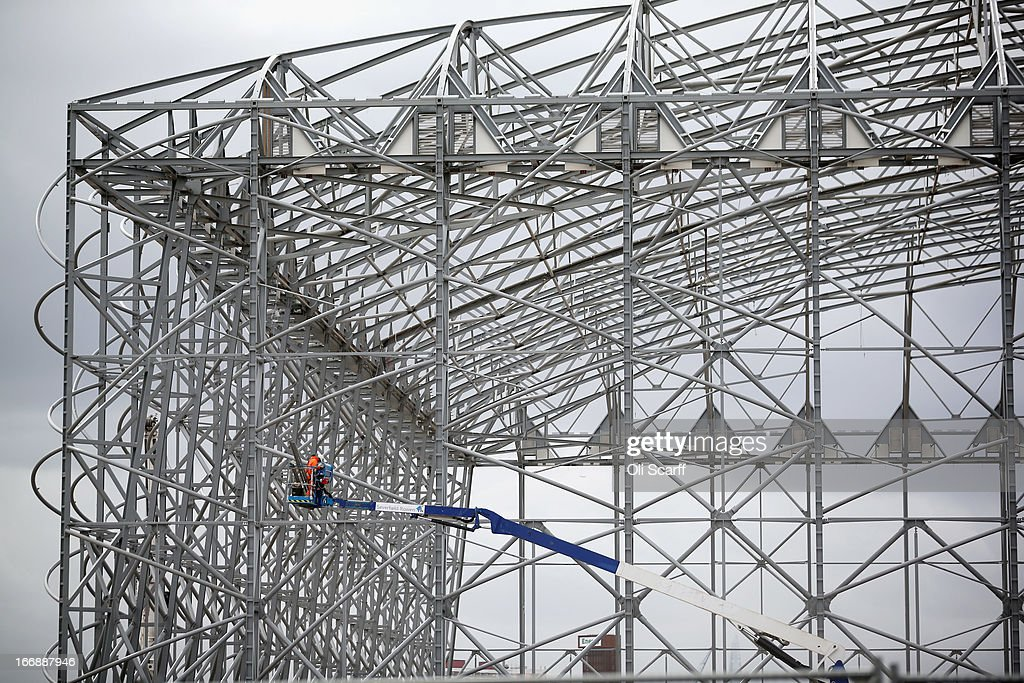 Workmen dismantle the basketball stadium, which was used in the London 2012 Olympic Games, prior to the opening of a portion of the park to the general public on April 16, 2013 in London, England. In 100 days the first section of the developed site of the 2012 Olympic Games, which will be known as Queen Elizabeth Olympic Park, will welcome visitors. The park's 292 million GBP conversion includes the removal of temporary venues, the refitting of stadia for public use, the removal of Olympic Games sponsor's retail units and extensive landscaping. The re-opening of the northern portion of the park will take place on July 27, 2013, on first anniversary of the London 2012 Olympics, for a festival celebrating the culture of East London. The park will be fully open to the public in spring 2014.