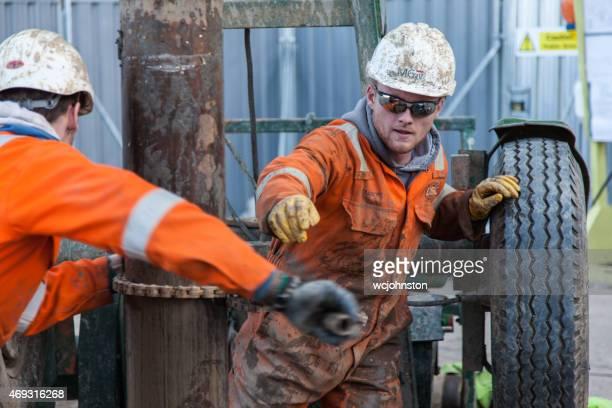 workmen drilling