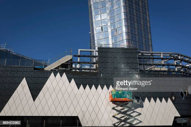 Workmen fix triangularshaped cladding to the exterior of a part of the One Blackfriars residential tower on 27th October 2017 in Southwark London...