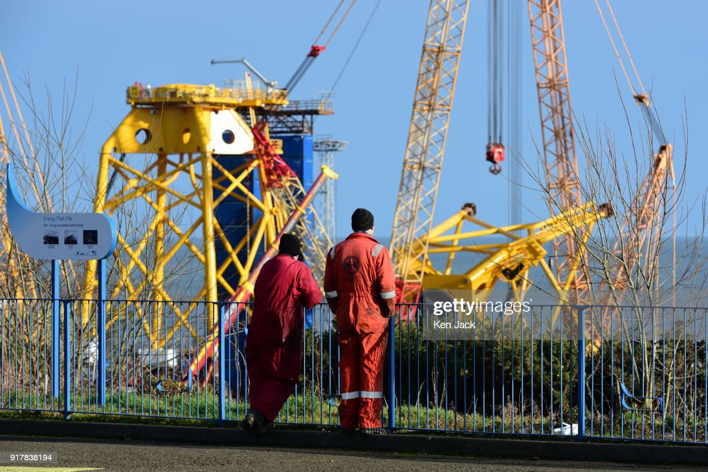 Workmen from another company view the giant steel structures under construction at the BiFab Methil Yard in Fife where many of the workforce were to be issued with redundancy notices today, on February 13, 2018 in Buckhaven, Scotland. The company faced possible administration following disputes over a contract to supply large-scale metal jackets for offshore wind turbines in 2017, but were enabled to continue trading by a deal brokered by the Scottish Government, however the contract is now nearing completion.