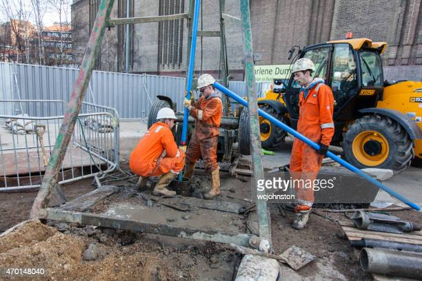 Workmen in orange overalls