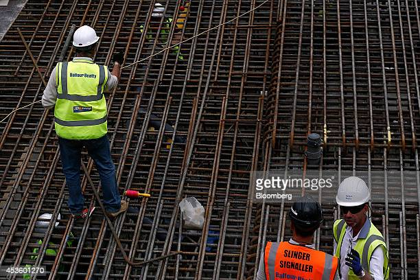 Workmen install metal reinforcement rods to support concrete during building works at Balfour Beatty Plc's St James's Market construction site a...