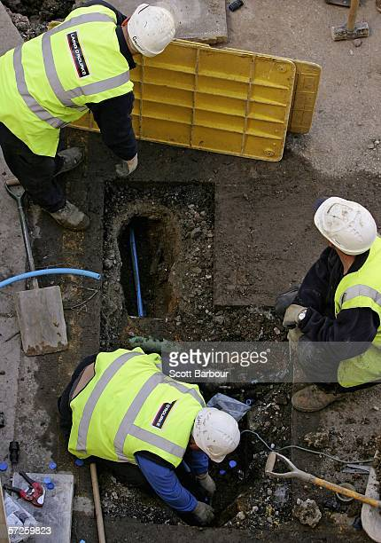 Workmen install new pipes as Thames Water begin replacing ageing water mains in a residential street on April 5, 2006 in London, England. Thames...