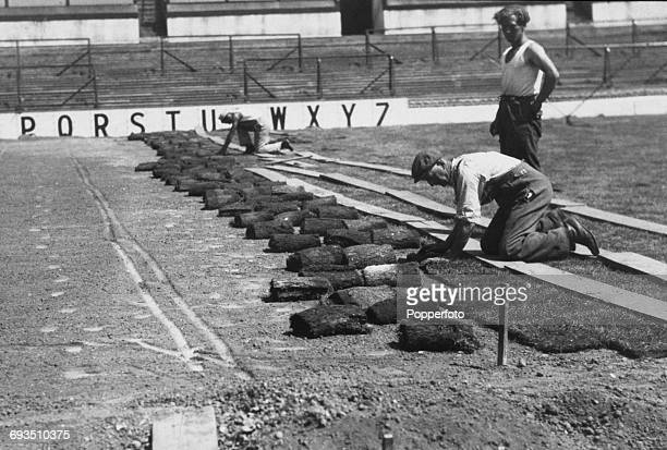 Workmen laying new turf on the pitch at Tottenham Hotspur's White Hart Lane ground London 1952